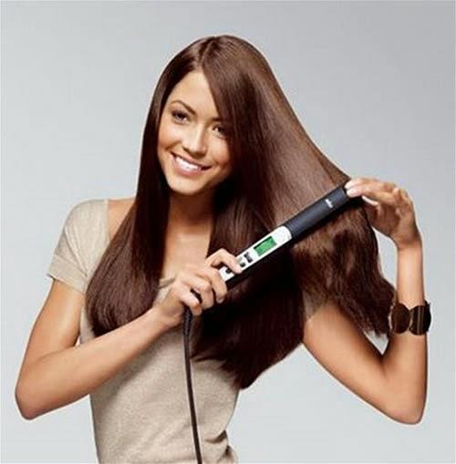 como planchar  el cabello
