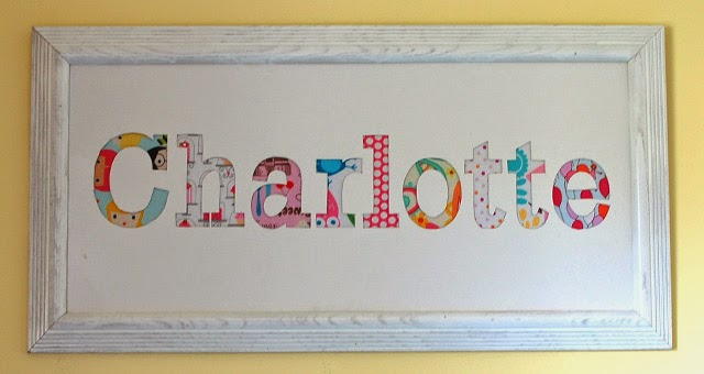 All things jane fabric scrap name art step 1 print out your childs name position it on tagboard sized to fit your frame tape in place and cut out the letters spiritdancerdesigns Gallery