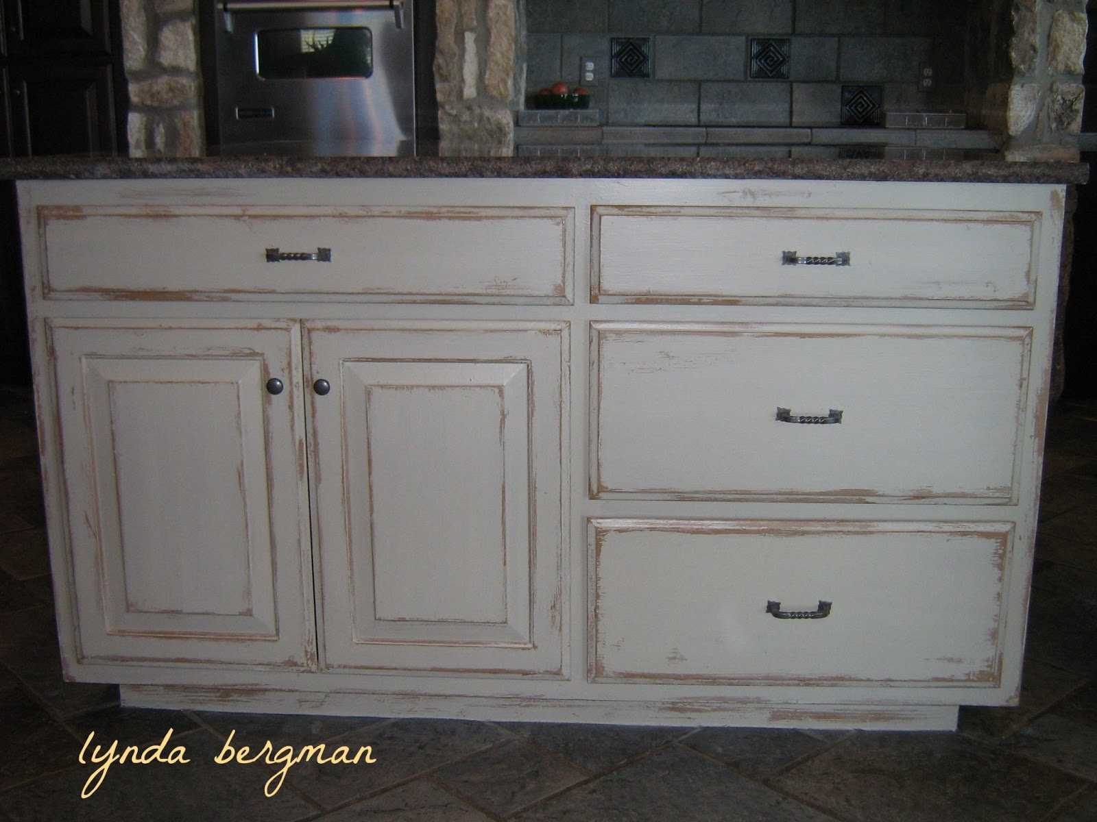 Lynda bergman decorative artisan white kitchen cabinets for Distressed kitchen cabinets