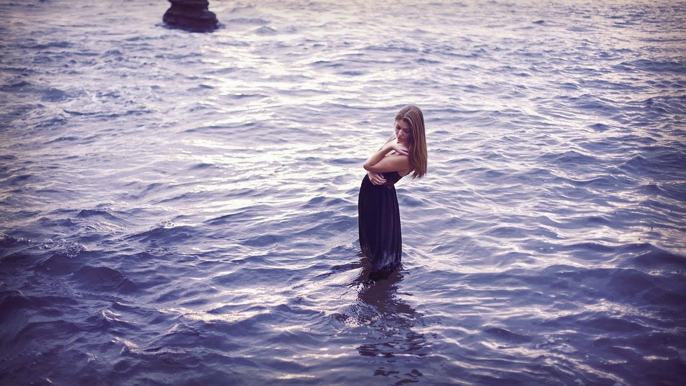 Girl rejoicing at Sea photo