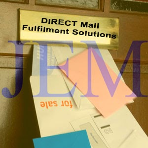 Image of JEM Logo on a door mail box overloaded with mail.