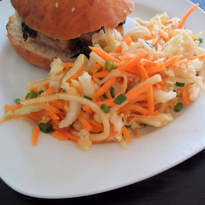 Asian Slaw:  An Asian themed slaw made with cabbage, daikon, and carrot mixed with an Asian-style vinaigrette.  A great accompaniment to an Asian Pork Burger or any burger.