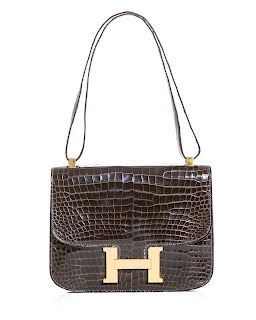 Vintage brown crocodile Hermes Constance bag with gold hardware.