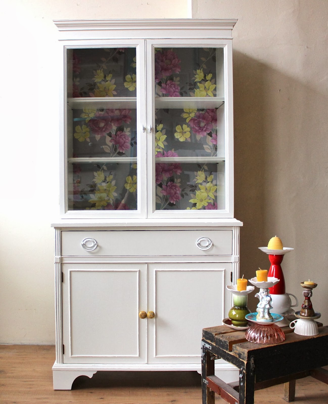 white china cabinet with floral interior