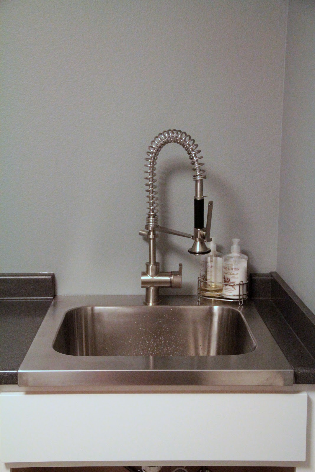 Laundry room sink. Both the sink and faucet are from Ikea.