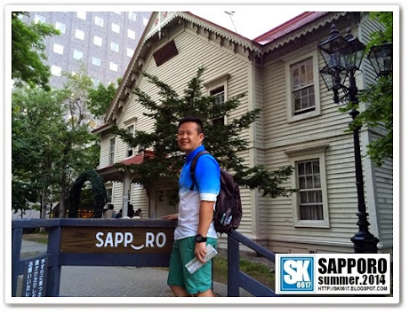 "Sapporo Japan - Posing with the ""Smiling Sapporo"", best spot to take a photo with the Sapporo Clock Tower"