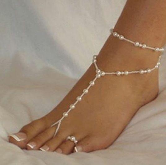 Descalza entre perlas