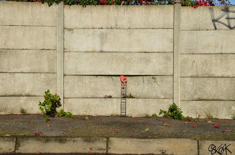 07-The-Escape-OakOak-Street-Art-Drawing-in-the-City-www-designstack-co