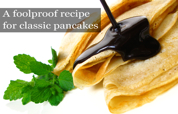 pancakes with chocolate sauce and mint