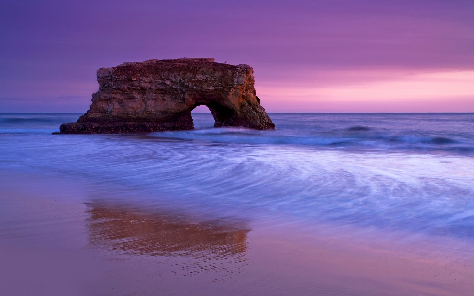 http://1.bp.blogspot.com/-Avpfd6MnajE/Tx2hcaqoIMI/AAAAAAAAAdA/a7amhdYmLkY/s1600/Wallpaper-sea-beach-arch-sunset-evening-cliff-photo.jpg