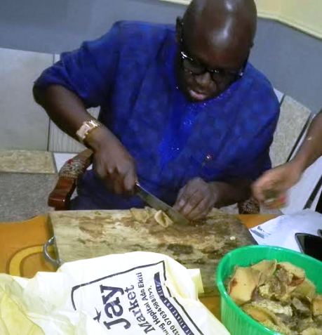 Photos: Gov. Fayose photographed cutting kpomo and meat