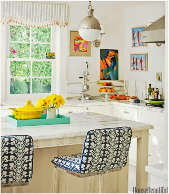 carrera marble countertops, colorful accents
