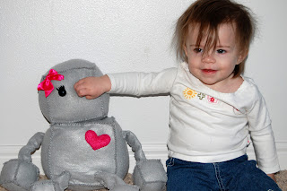 crazy hair toddler and stuffed robot