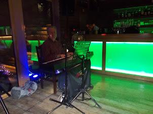 """The pianist/singer of """"Charles Bridge Restaurant"""" in Prague.."""