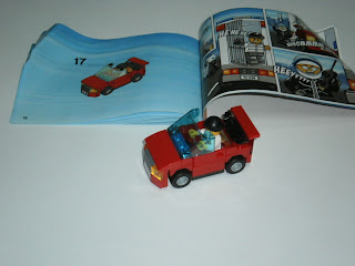 and a nice small red car with openable door for the robber the car is