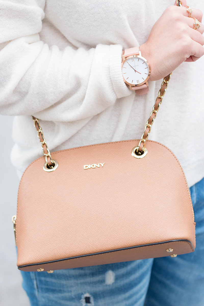 Berg + Betts round face watch and DKNY crossbody bag