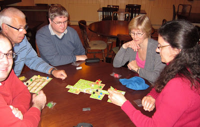 The team playing Carcassonne