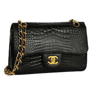 Vintage 1990's black crocodile Chanel bag with gold chain strap and hardware.