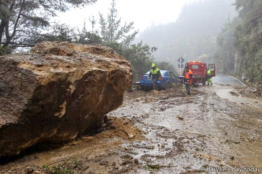 A car driven by a woman was crushed into the roadside barrier fence by huge rocks and a slip which closed SH2, the Napier-Wairoa Rd, just south of Devil's Elbow, after steady rain turned trickling mountain streams into torrents. photograph