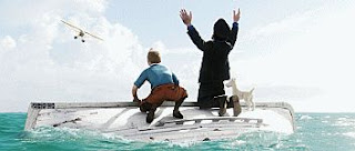 color movie still image of the rescue of shipwrecked Tintin, Captain Haddock and Snowy