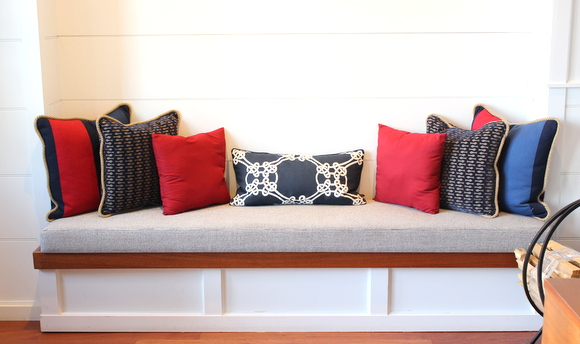 These accent throw pillows add pops of color to the built-in bench.
