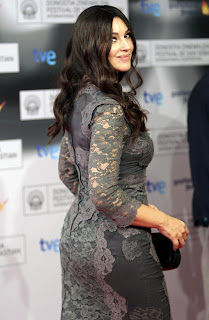 Monica Bellucci shows off her killer curves in a grey gown