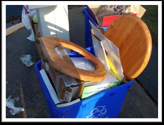 toilet seat in recycling bin
