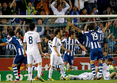 Espanyol players celebrate a goal against Real Madrid