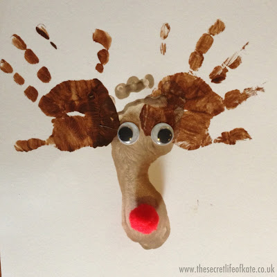 Rudolph the reindeer made from foot and hand prints