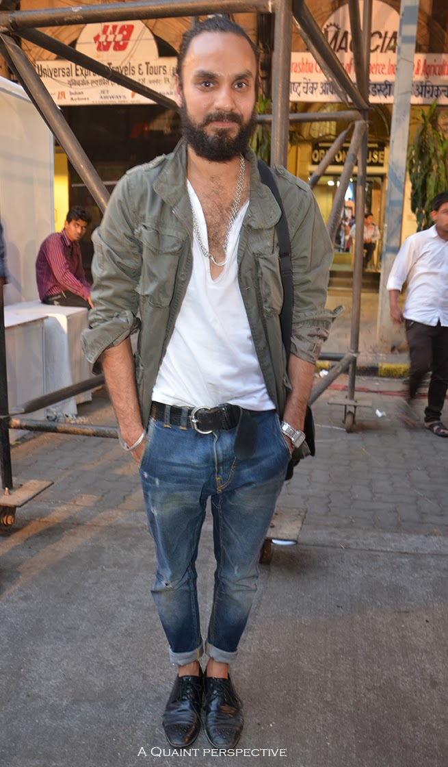 Jagvir wears this henley shirt in white over this amazing pair of denims with a great wash and vintage feel.