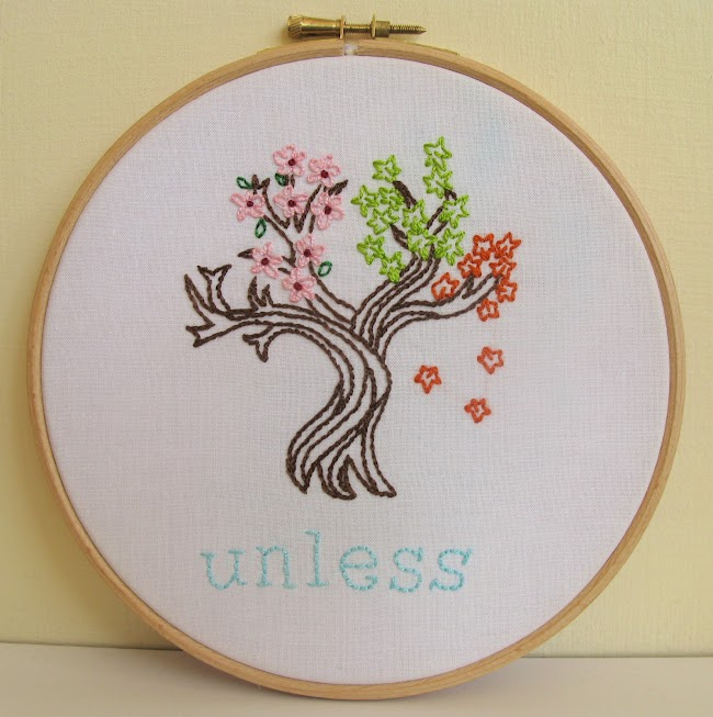 embroidered tree with leaves representing different seasons and the word unless stitched underneath