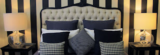 Hight quality bedhead has been used as the centre piece and wall paper and cushions have been used to build around it.