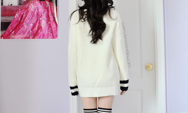SheInside's V-neck sweater is cozy, casual, and cute, with a baggy fit, contrasting trims, and deep V-neckline.