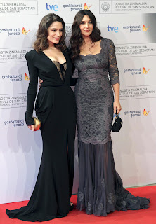 Monica Bellucci posing on the red carpet with her co star