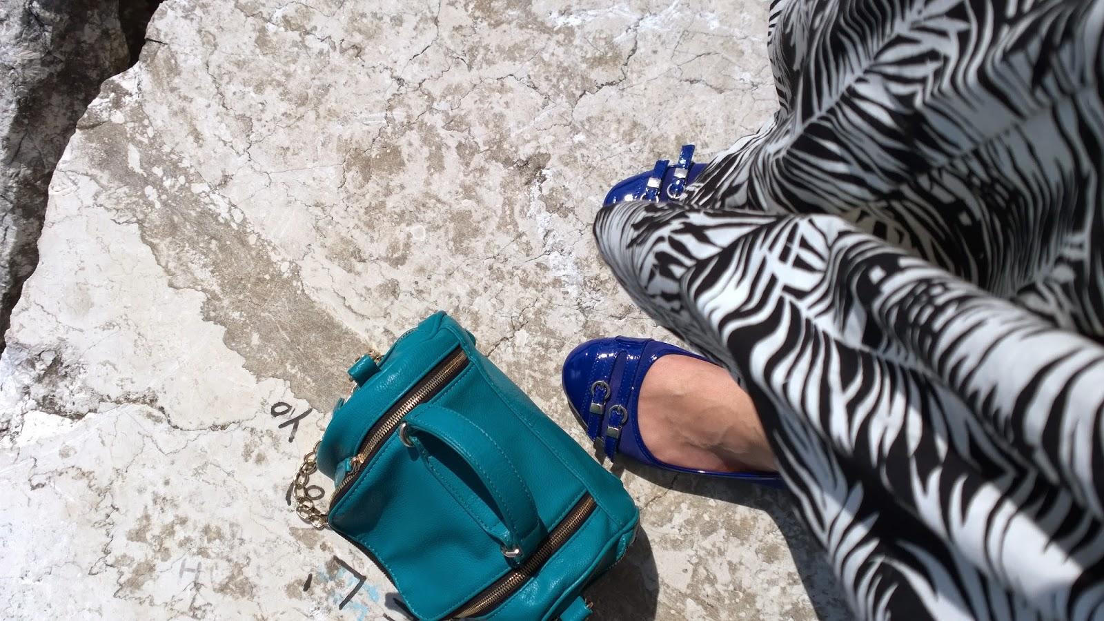 Blue flats, emerald bag, printed skirt