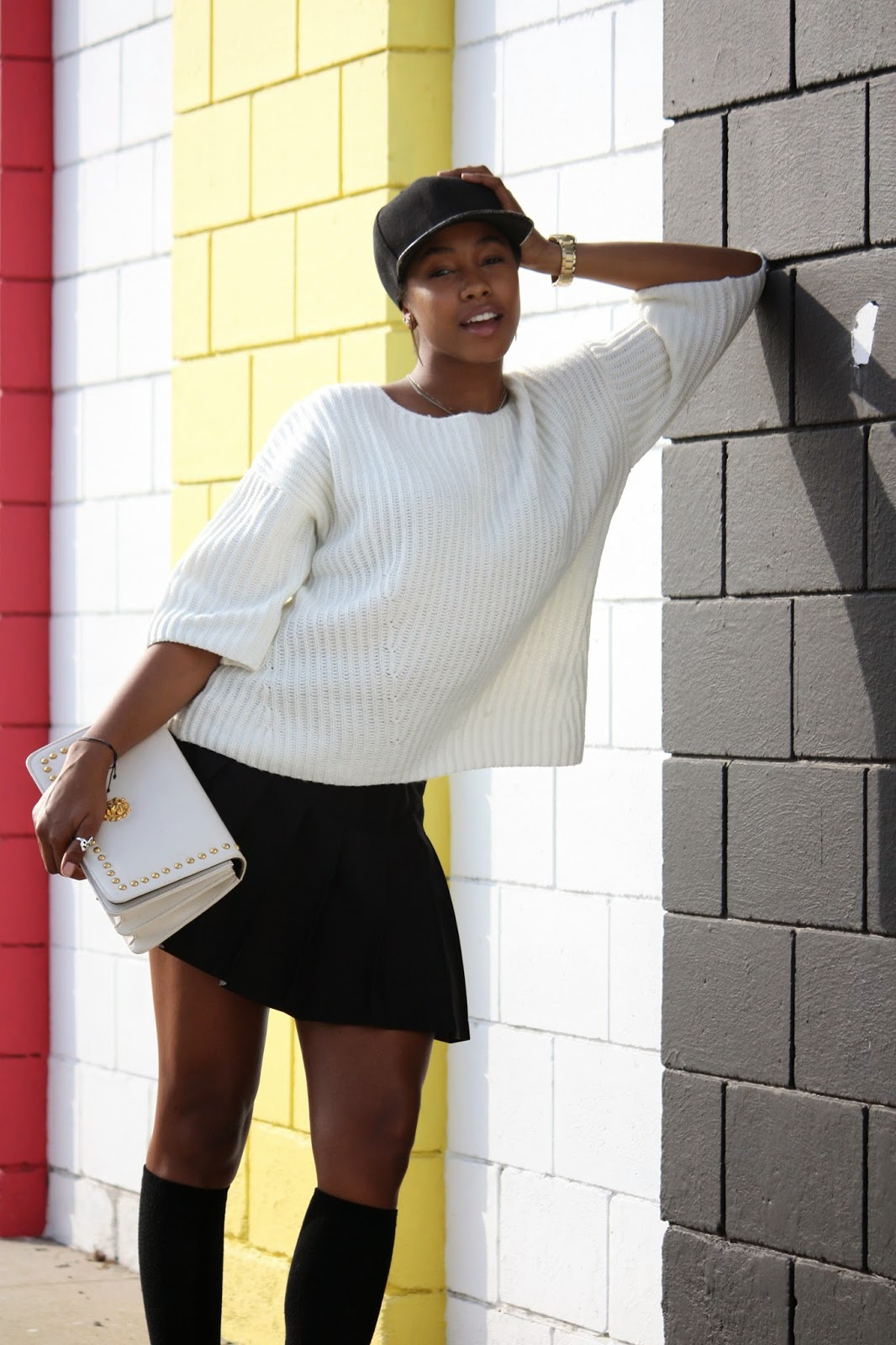 Outfit details: generic baseball cap H&M knit top American Apparel tennis skirt Vintage bag