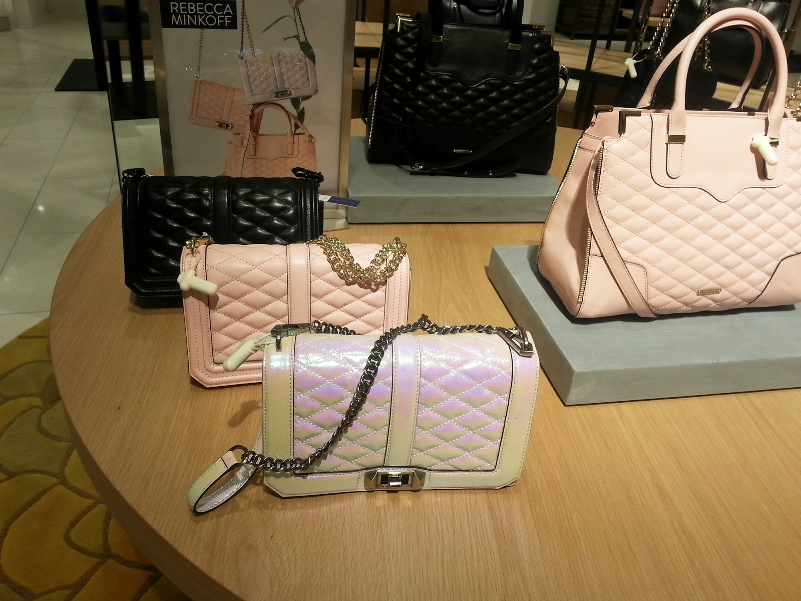 Rebecca Minkoff Love bags in black, pink, and opal.