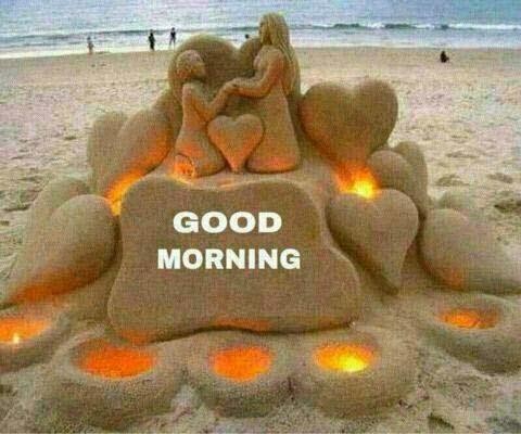 good morning written on sand