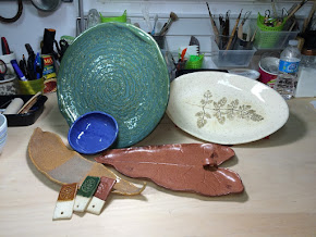 Deb uses botanical materials imprinted into the wet clay to help decorate exquisite platter and...
