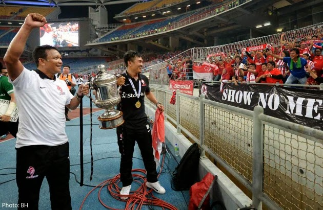 Fandi Ahmad and Nazri Nasir celebrates after LionsXII defeating Kelantan 3-1 in the FA Cup Final held at Bukit Jalil stadium, 23 May 2015.