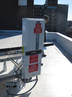 The inverter is mounted underneath the solar panels on the roof