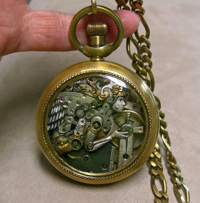01-Angel-Recycled-Watch-Sculptures-Steampunk-Susan-Beatrice-All-Natural-Arts-www-designstack-co