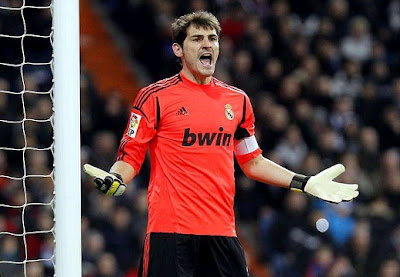 Iker Casillas playing with the Real Madrid jersey against Valencia in a Spanish Cup 2012-2013 match