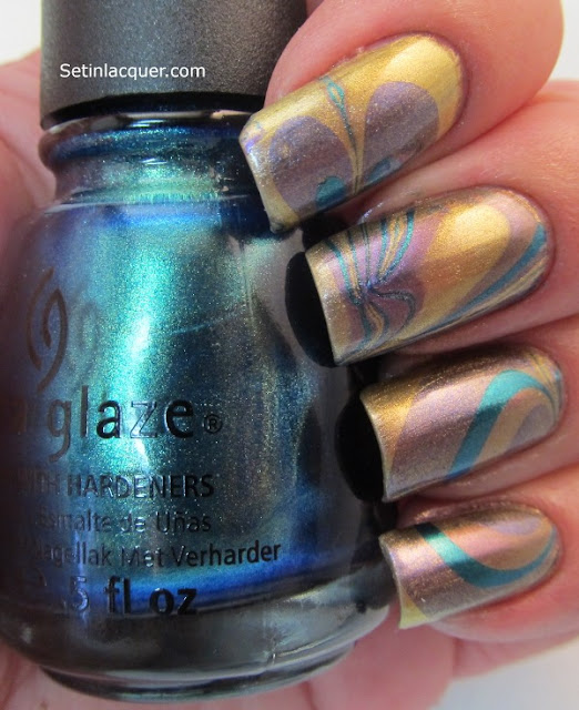 Water marble using some of the polishes from the China Glaze Bohemian Collection.