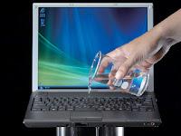 pertolongan pertama pada Laptop Terkena Tumpahan Air