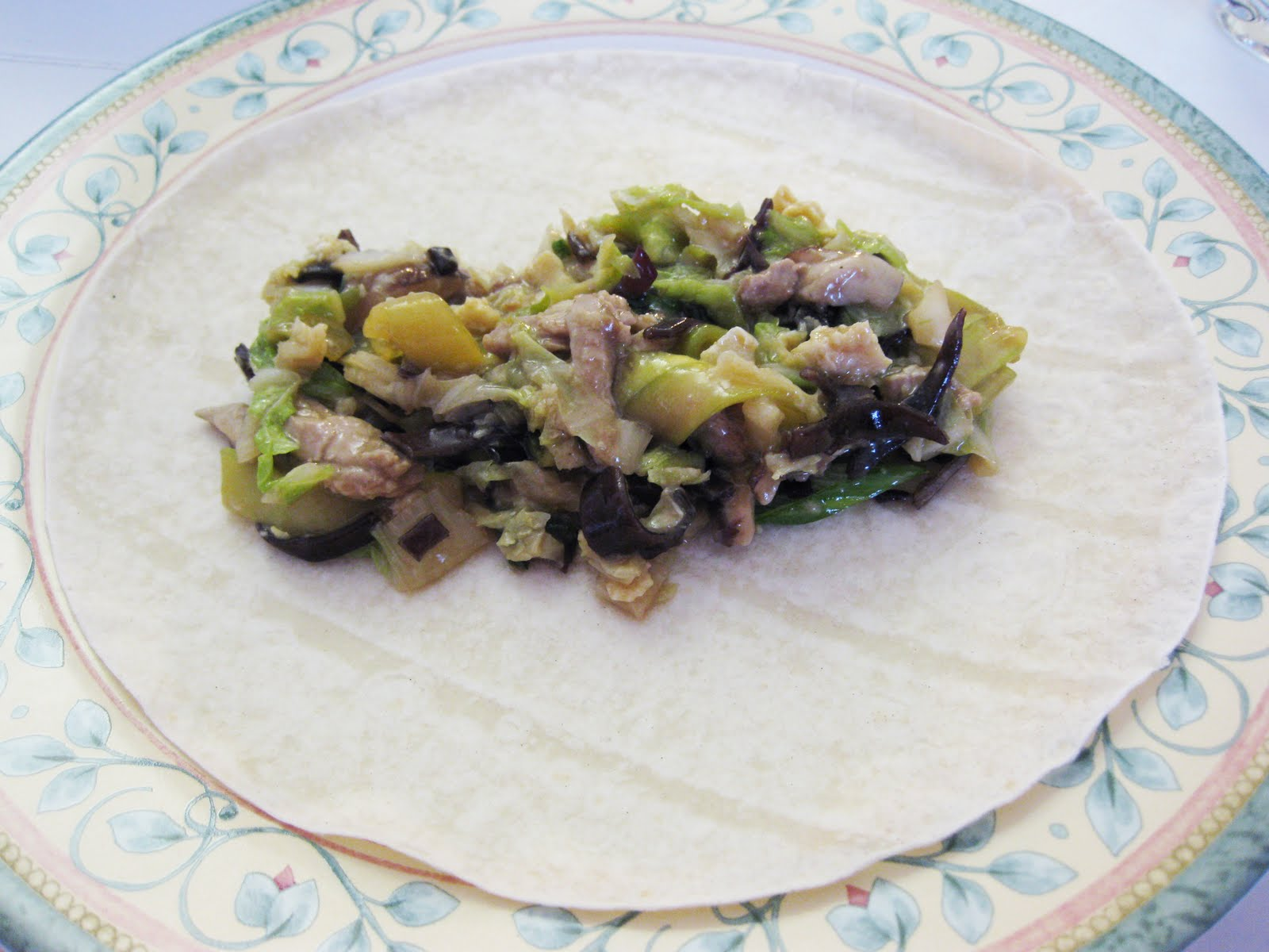 moo shu pork, garnished with scallions