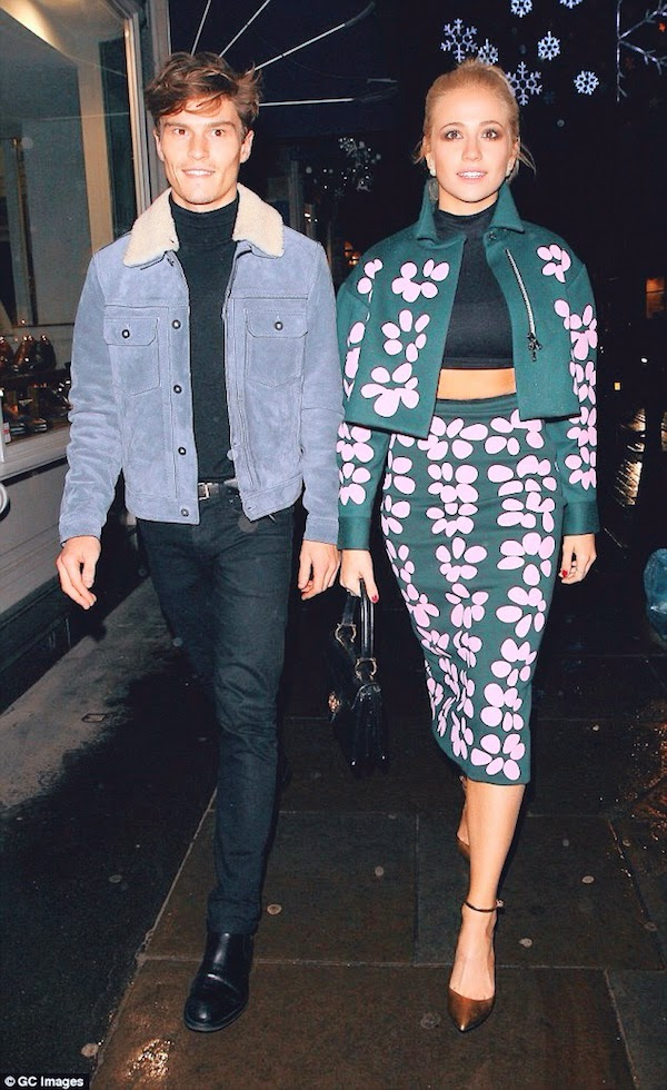 Pixie Lott with Oliver Cheshire in Coach menswear Fall Winter 2014 blue suede leather jacket with white shearling collar - London 9th December 2014