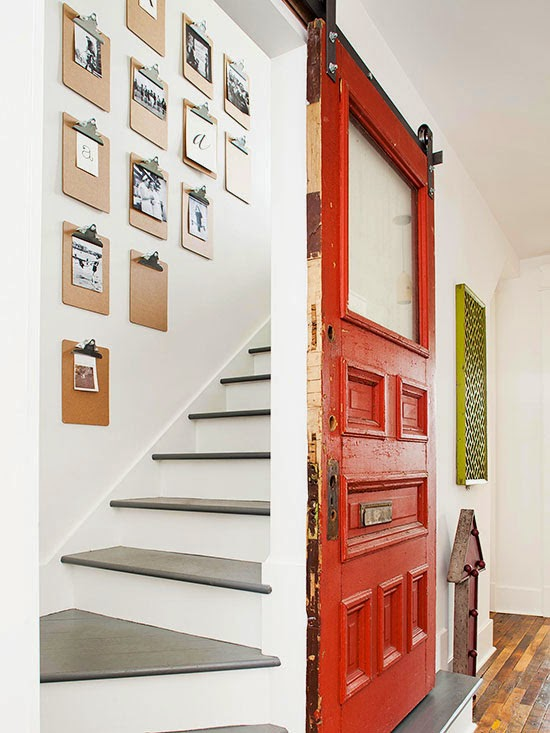 Love this salvaged door that opens to this rustic modern gallery wall and simple gray white staircase