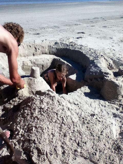 Digging a sand castle image 1