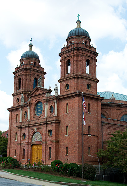 Angle view of the brick exterior of St Lawrence Basilica in Asheville North Carolina
